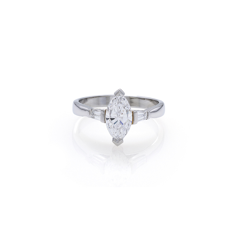 A solitaire marquise cut diamond Engagement Ring