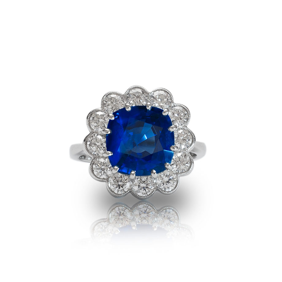 A Platinum Sapphire and Diamond Cushion Cluster Ring