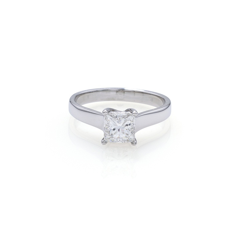 A contemporary style solitaire princess cut diamond ring